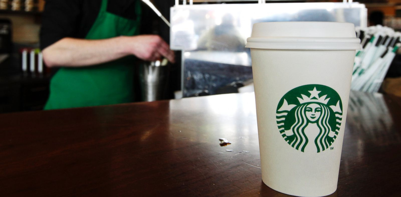 PHOTO: A Starbucks drink waits for a customer to pick it up as a barista prepares another, in Seattle.