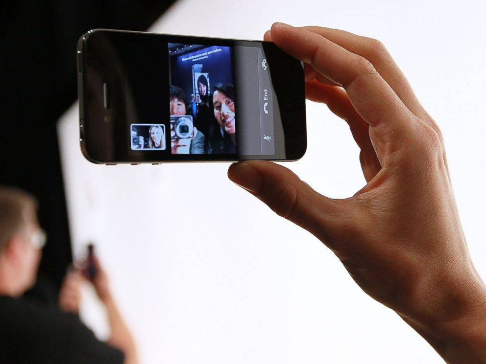 PHOTO: An Apple employee demonstrates Face Time on the new iPhone 4 at the 2010 Apple World Wide Developers conference June 7, 2010 in San Francisco, California.