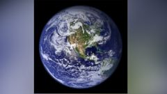 PHOTO: Picture of earth showing the entire North American continent, Central America, the northern half of South America, Greenland and the Pacific and Atlantic Oceans.