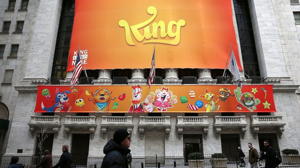 PHOTO: A banner for the mobile gaming company King is seen outside the New York Stock Exchange during Kings initial public offering, March 26, 2014, in New York.