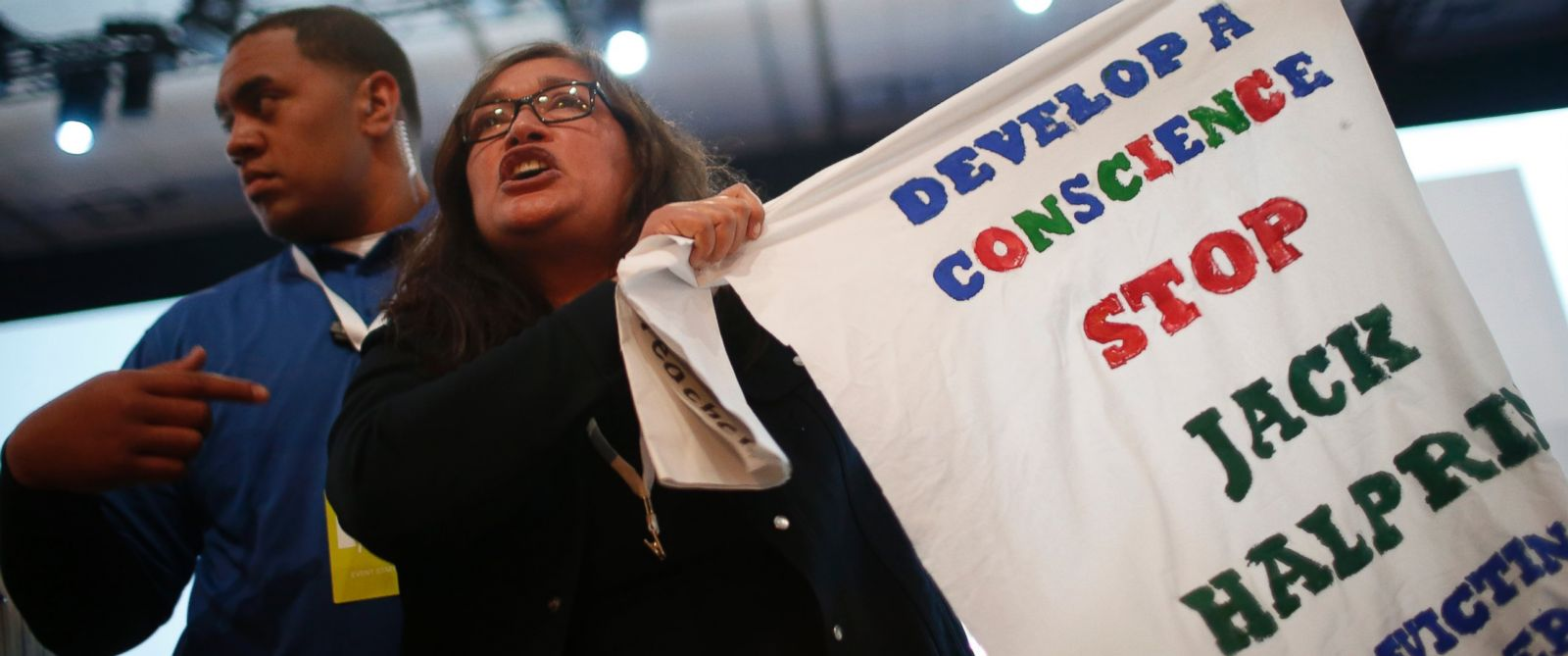 PHOTO: A demonstrator waves a sign in protest of Google during the Google I/O Developers Conference