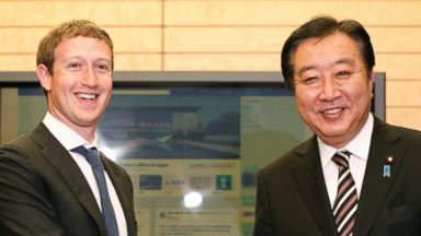 PHOTO: Facebook CEO Mark Zuckerberg, left, shakes hands with Japans Prime Minister Yoshihiko Noda in front of a monitor displaying a facebook page of Prime Ministers Office of Japan in this March 29, 2012, file photo.