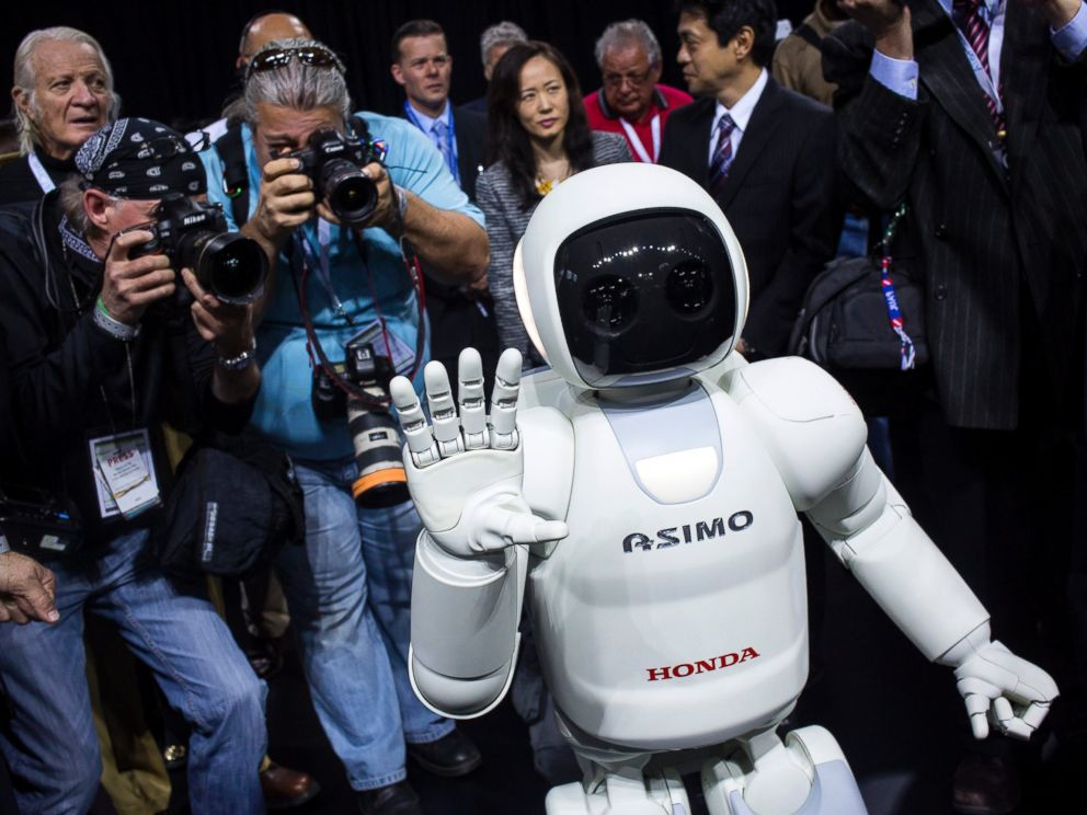 PHOTO: Honda Motors demonstrates its Asimo robot during a media preview of the 2014 New York International Auto Show in New York. The show opens with a sneak preview to the public April 18 and runs through April 27.