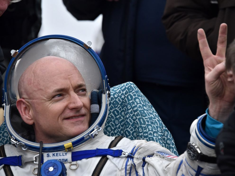 PHOTO: International Space Station (ISS) crew member Scott Kelly of the U.S. shows a victory sign after landing near the town of Dzhezkazgan, Kazakhstan, on March 2, 2016.