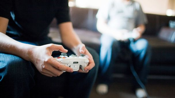 PHOTO: People play video games.
