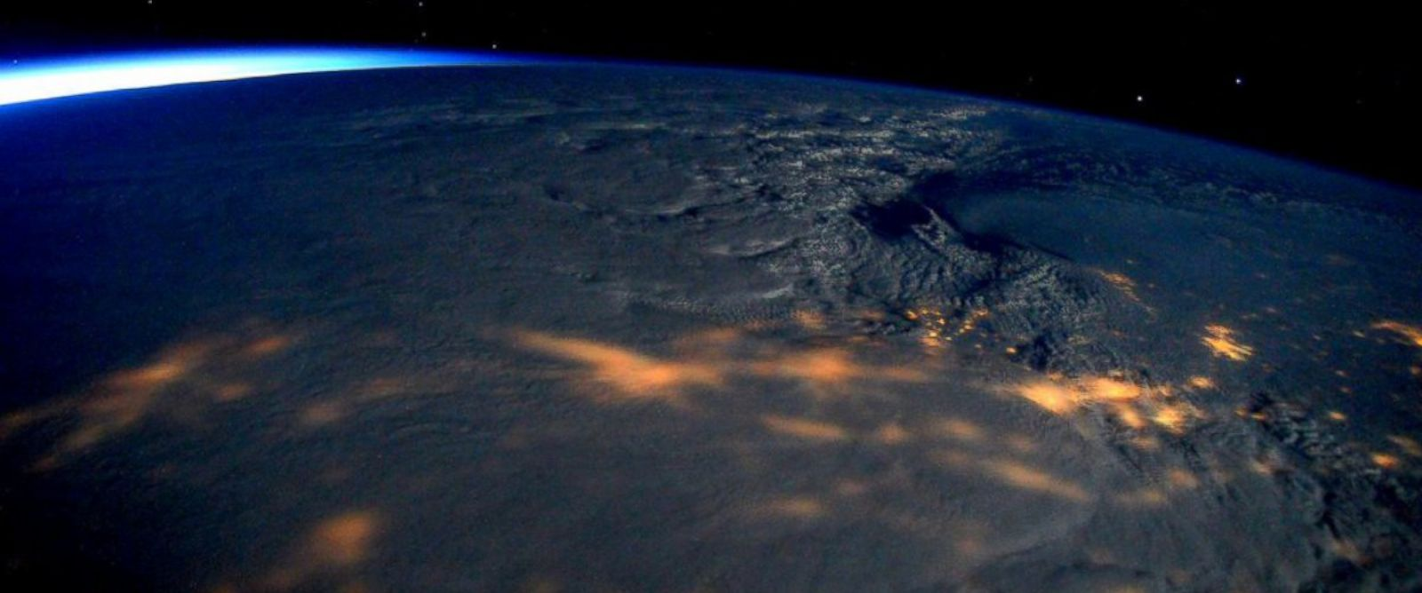 """PHOTO: Scott Kelly posted this photo to Twitter, Jan, 23, 2016 with the caption, """"Massive #snowstorm blanketing #EastCoast clearly visible from @Space_Station! Stay safe!"""""""