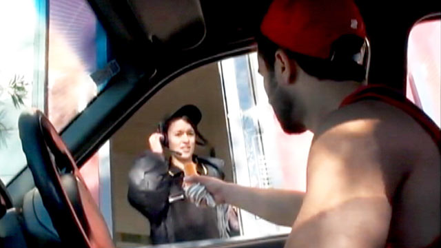 PHOTO: Alki Stevens shocks fast food workers by grabbing ice cream cones from the top known as cone-ing.