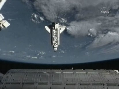 VIDEO: Endeavour docks at international space station.