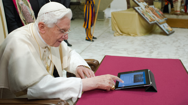 PHOTO: In this photo provided by the Vatican newspaper LOsservatore Romano, Pope Benedict XVI pushes a button on a tablet at the Vatican, Dec. 12, 2012.