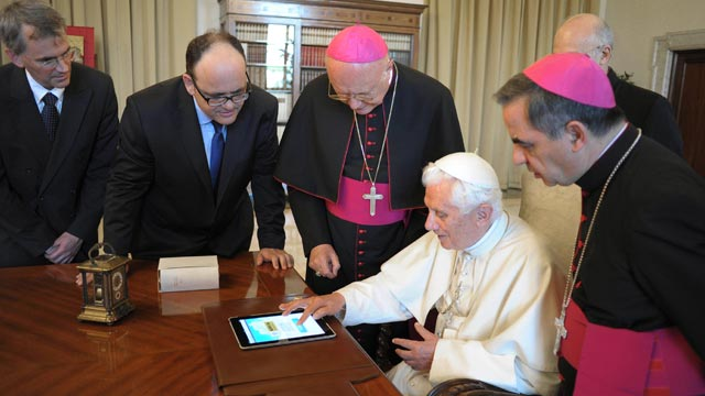 "PHOTO: Pope Benedict XVI touches an iPad to send a tweet for the launch of the Vatican news information portal ""www.news.va"", at the Vatican, June 28, 2011."