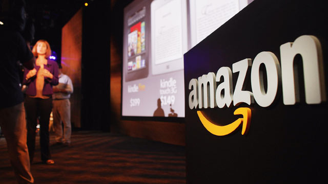 PHOTO: Members of the media cover the launch of the new Amazon tablet called the Kindle Fire,New York City, Sept. 28, 2011.