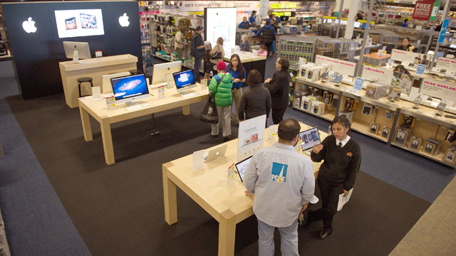 PHOTO: Customers look at Apple Inc. products at a Best Buy Co. store in San Francisco, Dec. 9, 2011.