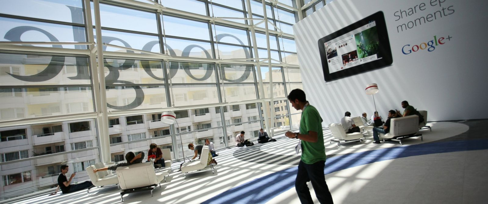 PHOTO: A Google logo is seen through windows of Moscone Center in San Francisco during Googles annual developer conference in San Francisco on June 28, 2012.