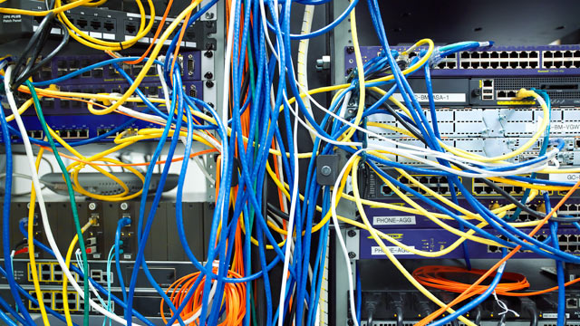 PHOTO: A tangled mess of network cables.