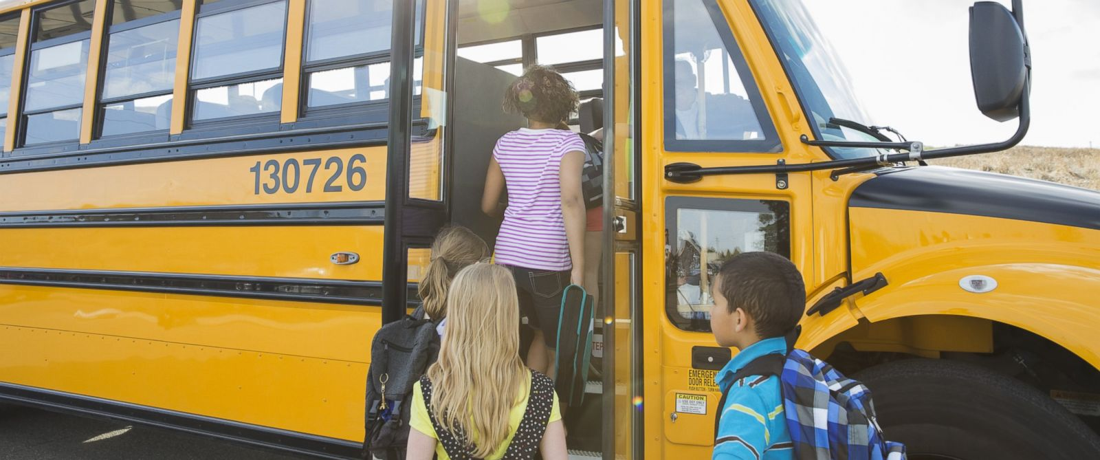 PHOTO: Children board a school bus in an undated stock photo.