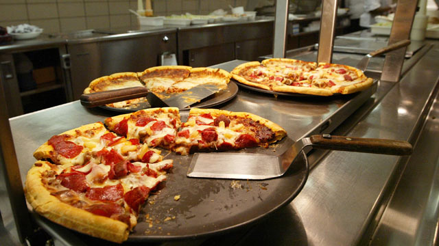 PHOTO: Pizzas available for lunch are seen in the kitchen at Jones College Prep High School in Chicago, Illinois.