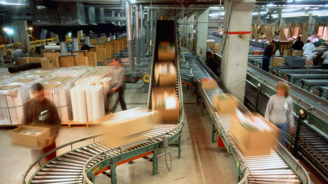 PHOTO: Boxes on conveyor belt in a mailroom.