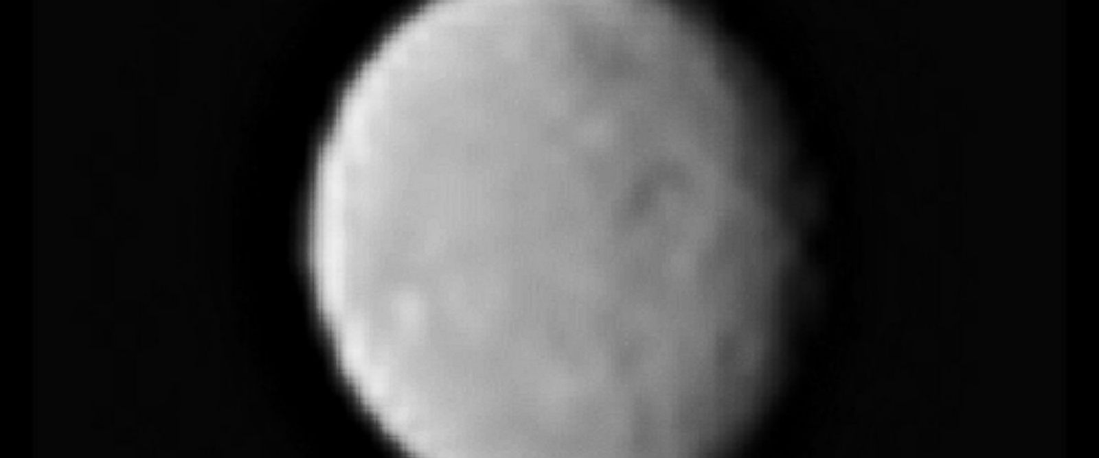 PHOTO: This processed image, taken on Jan. 13, 2015, shows the dwarf planet Ceres as seen from the Dawn spacecraft. The image hints at craters on the surface of Ceres. Dawns framing camera took this image at 238,000 miles from Ceres.