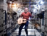 "PHOTO: Astronaut Chris Hadfield performs ""Space Oddity"" from space in a video that has gone viral on YouTube."