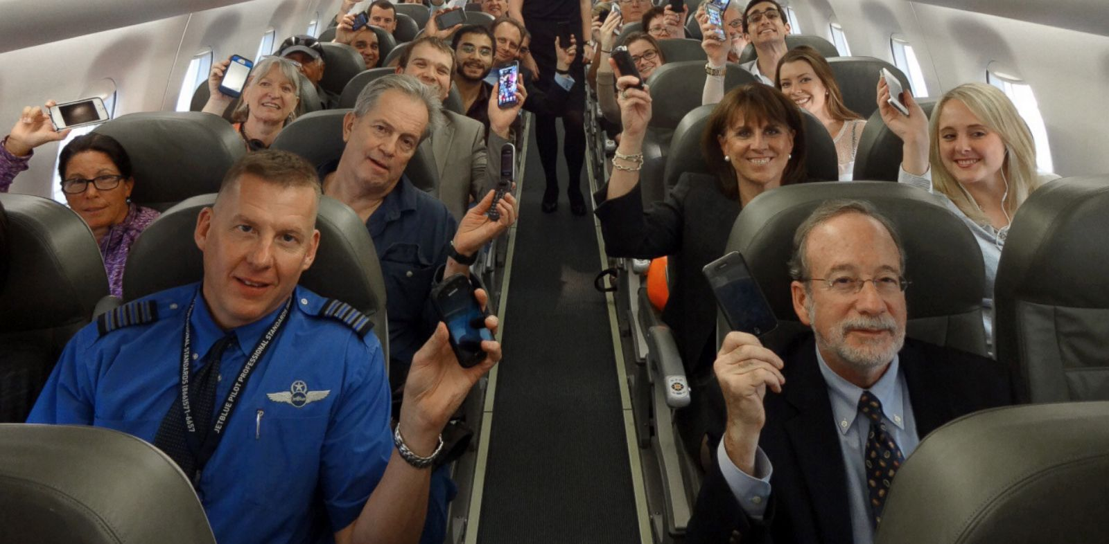 PHOTO: Passengers on JetBlue Flight 2302, the first flight to allow use of electronic devices during takeoff and landing.