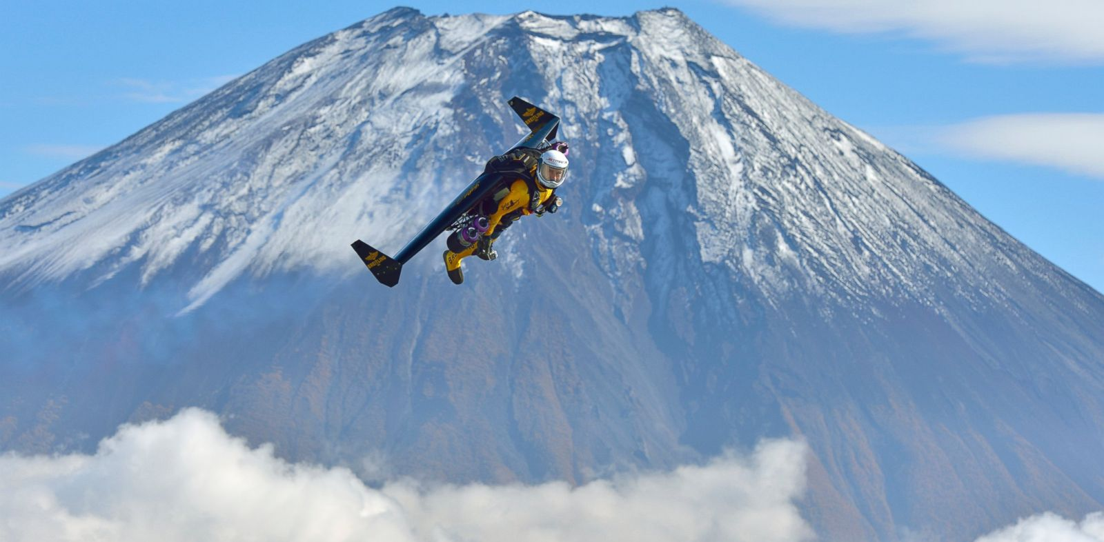 PHOTO: Yves Rossy, known as the Jetman, flies by Mount Fuji in Japan, Nov. 1, 2013.