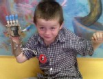 PHOTO: Liam with new mechanical hand