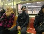 """PHOTO: Google co-founder Sergey Brin is seen in on the subway in this image posted on Twitter on Jan 21, 2013 by Noah Zerkin, who noted in his caption: """"Yeeeah... I just had a brief conversation with the most powerful man in the world. On the downtown 3 t"""