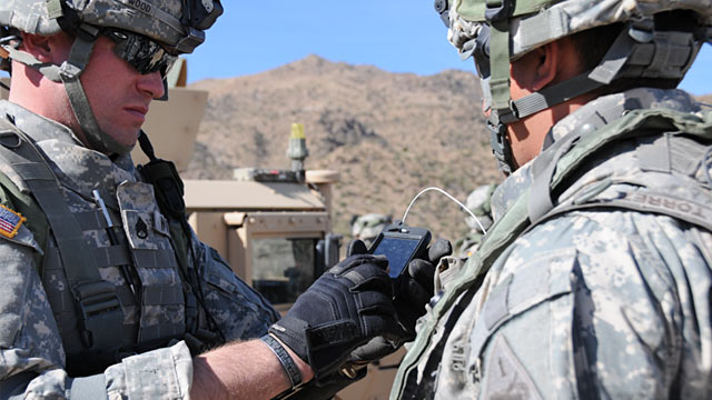 PHOTO: Soldiers using consumer smartphones during field exercises