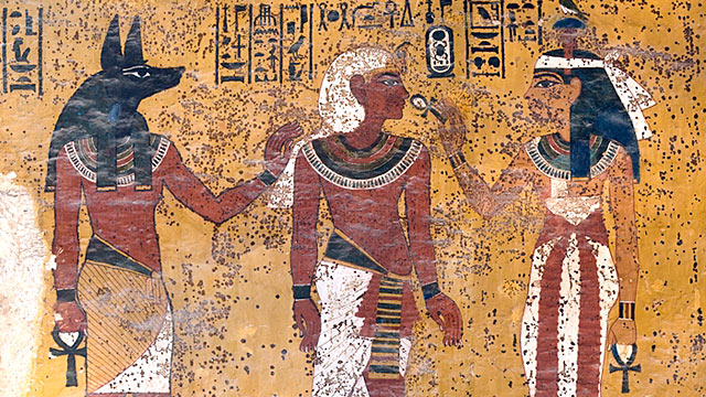 PHOTO:In Tutankhamens tomb, Hathor, goddess of the west, welcomes the pharaoh to the underworld. Note brown splotches on the wall.