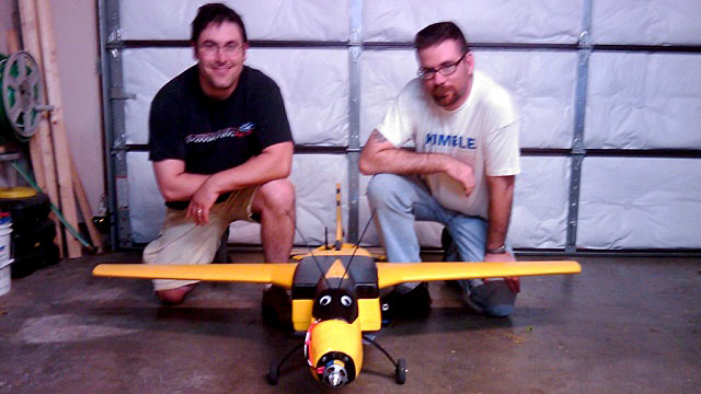 PHOTO: Seen here is Richard Perkins and Mike Tassey with an early Wireless Aerial Surveillance Platform, aka WASP drone airplane model.