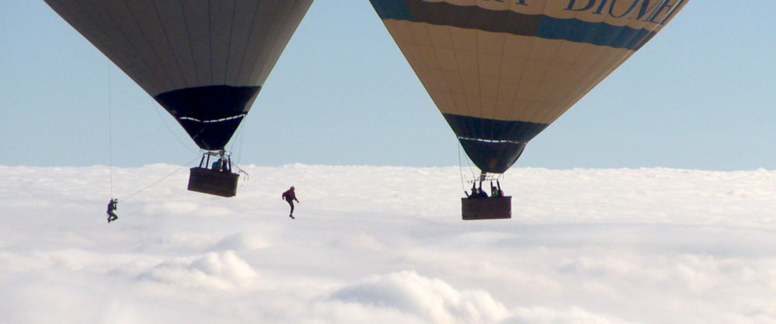 """The """"Flying Frenchies"""" perform a death-defying stunt -- a tight-rope walk between two hot air balloons -- for ABC News in 2014."""