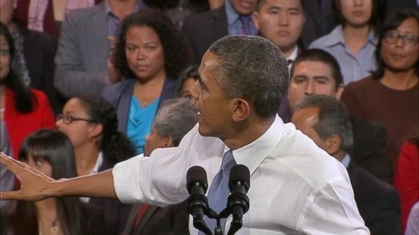 PHOTO: Heckler behind Obama steals attention away from presidents speech.