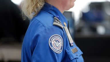 PHOTO: A Transportation Security Administration inspector works at a security checkpoint at Lambert-St. Louis International Airport, April 12, 2016, in St. Louis.