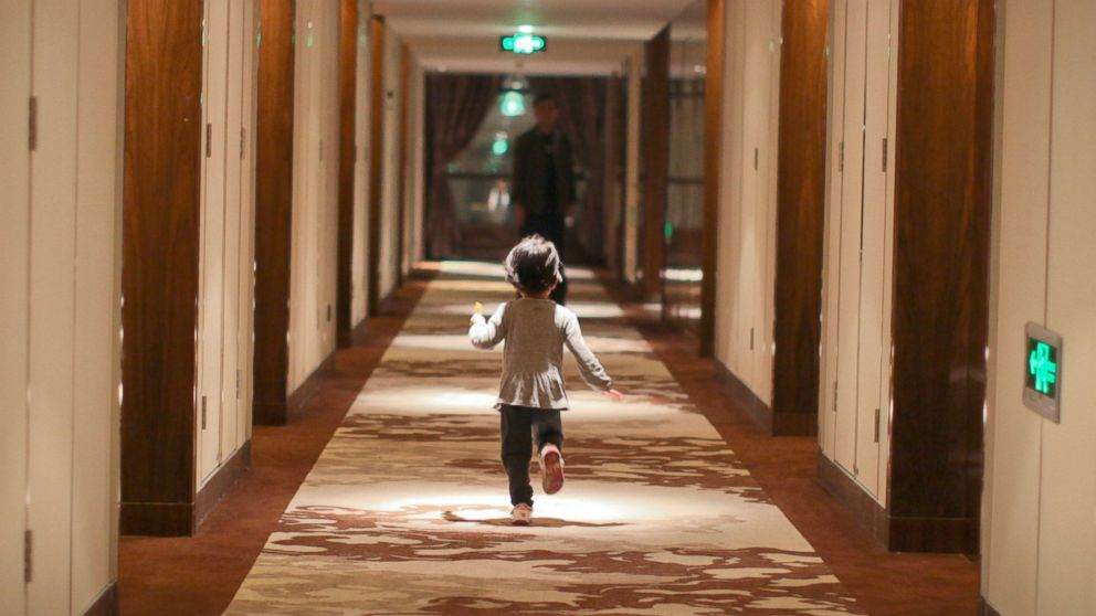 PHOTO: Child running in the hotel corridor.