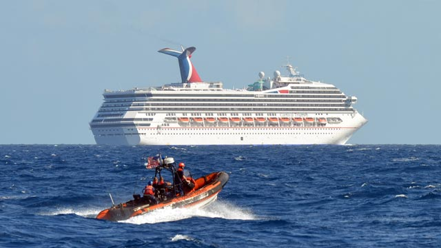 PHOTO: A small boat belonging to the Coast Guard Cutter Vigorous patrols near the cruise ship Carnival Triumph in the Gulf of Mexico, Feb. 11, 2013.