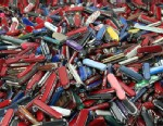 PHOTO: Knives of all sizes and types are piled in a box. They are just a few of the hundreds of items discarded at the security checkpoints of Hartsfield-Jackson Atlanta International Airport.