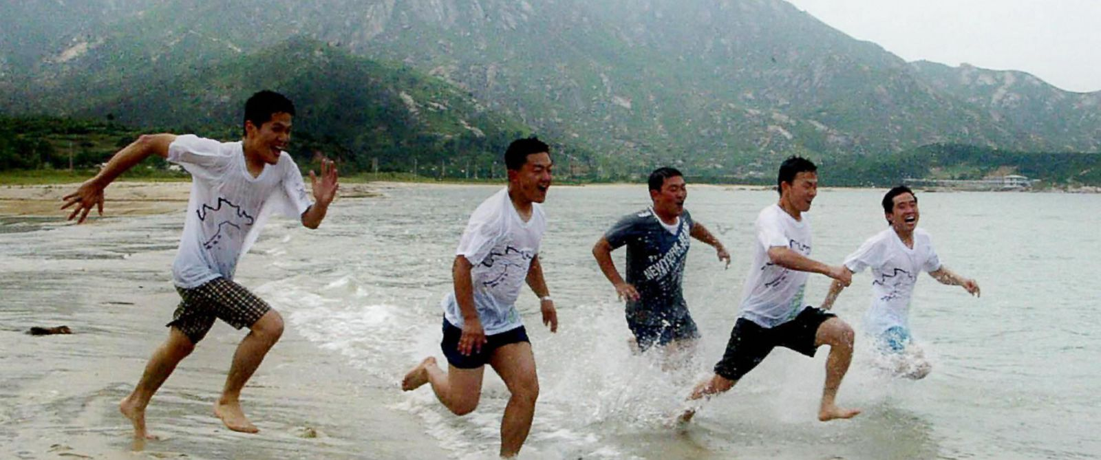 PHOTO: South Korean tourists on Kumgangsan beach in Kosung, North Korea, July 3, 2004.