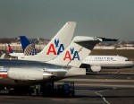 PHOTO: American Airlines Inc. and United Continental Hoildings planes taxi on the runway at LaGuardia Airport in Queens, New York, Nov. 21, 2012.