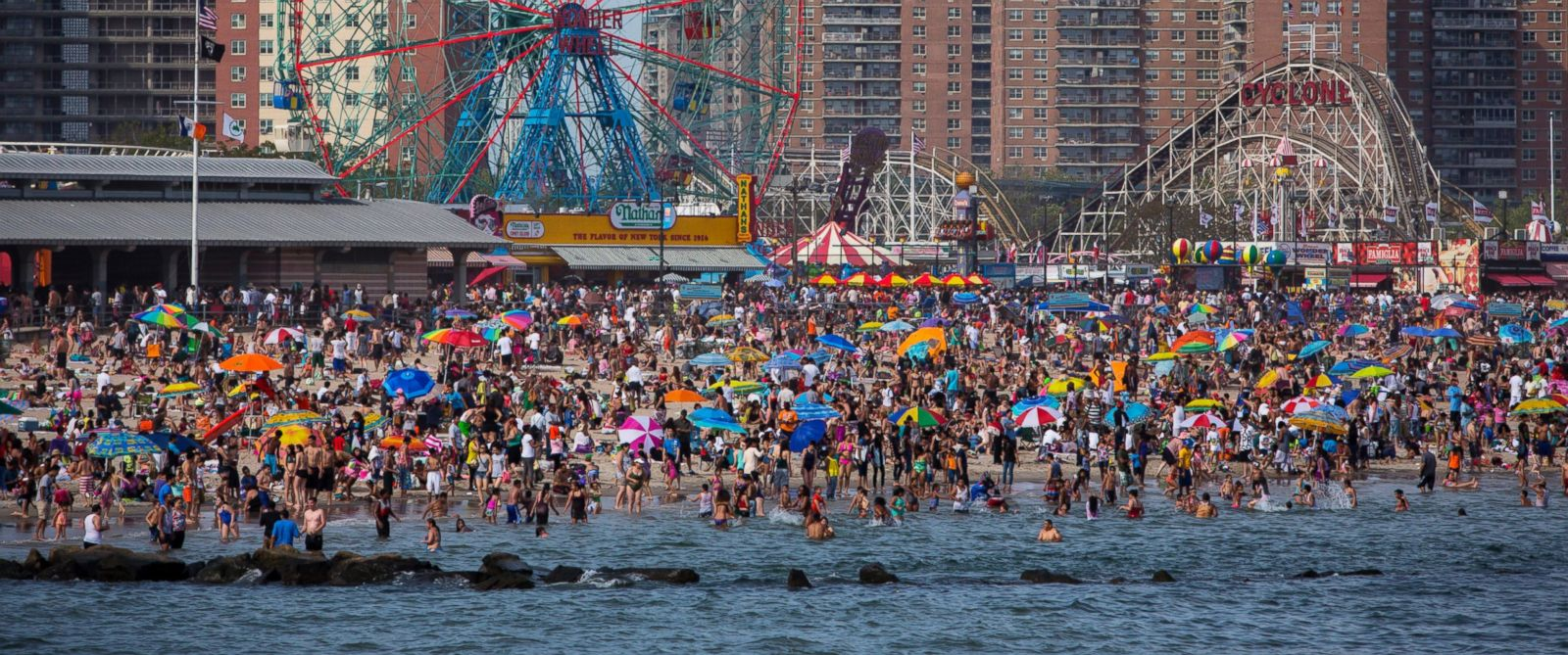 PHOTO: People crowd the beach at Coney Island on Memorial Day, May 26, 2014 in the Brooklyn borough of New York City.