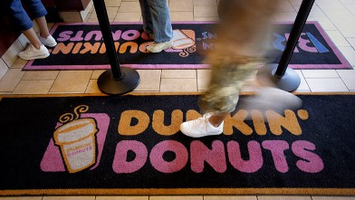PHOTO: A customer enters at a Dunkin' Donuts store in New York, July 25, 2012.
