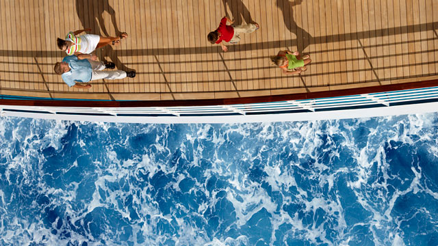PHOTO: An aerial view of a family on a cruise ship and the ocean.