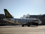 PHOTO: A Frontier Airlines plane taxis at Denver International Airport in Denver, Dec. 2, 2011.