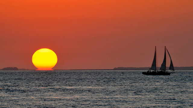 PHOTO: The sun sinks over the Gulf of Mexico seen from Key West, Florida February 21, 2011.