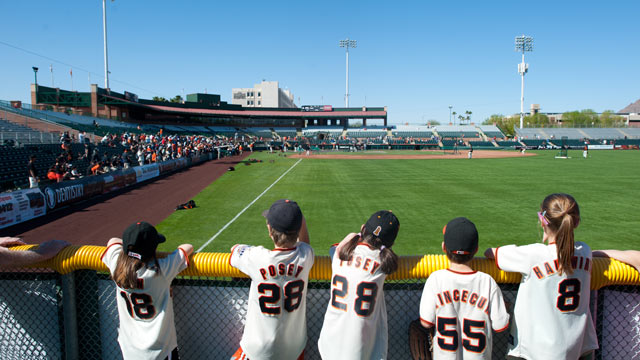 PHOTO: A general view of young baseball fans behind the outfield wall before a spring training game during batting practice at Scottsdale Stadium on March 3,2012 in Scottsdale, Ariz.