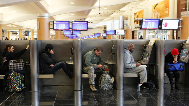 PHOTO: Delayed and stranded passengers waiting for flight information fill cubicles throughout Atlanta Hartsfield-Jackson International Airport after a snow storm, Jan. 10, 2011 in Atlanta, Georgia.