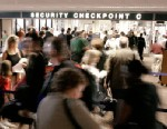 PHOTO: Airline passengers wait in line at a security checkpoint in terminal four at Phoenix Sky Harbor International Airport in this December 10, 2004 file photo from Phoenix, Arizona.