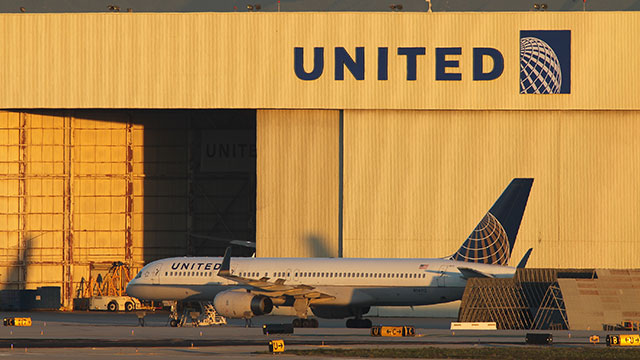 PHOTO: With its Boeing 787 Dreamliner jets grounded, a Boeing 777 jet is parked near a United Airlines hanger before a new day of service as United Airlines carries on with its fleet of 777s at Los Angeles International Airport (LAX) on January 17, 2013 i