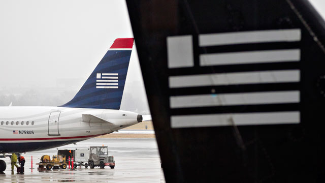 PHOTO: US Airways planes sit on the tarmac at Ronald Reagan National Airport in Washington, D.C., Jan. 23, 2012.