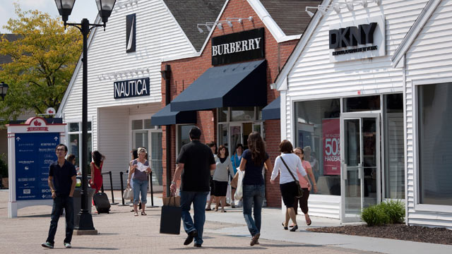PHOTO: Shoppers walk along the outdoor mall at the Premium Outlets at Woodbury Common, a division of Simon Property Group Inc., in Central Valley, New York, U.S., on on Sept. 13, 2011.
