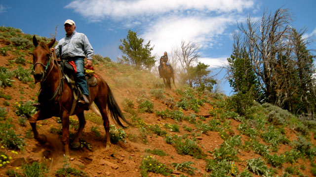 PHOTO: Nick Battiste, (in foreground) and Nikki Battiste in background during a dude ranch ride.